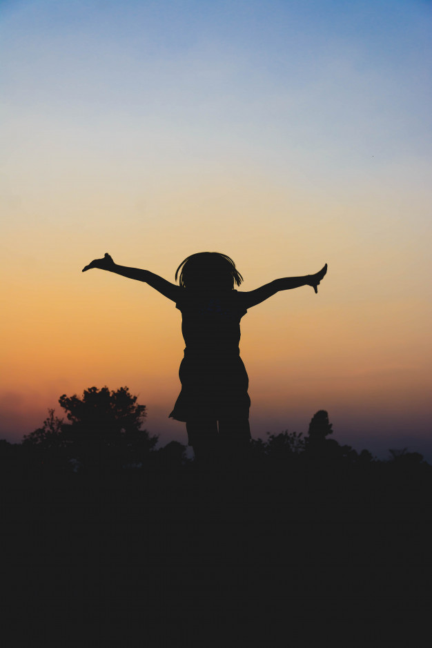 silhouette-kids-running-enjoy-midst-rice-field-sunset_40836-472